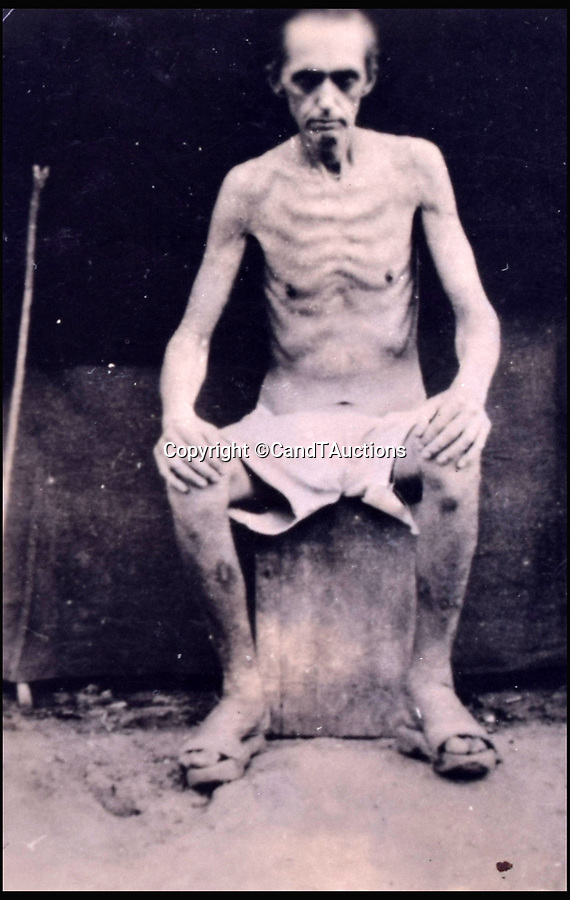 BNPS.co.uk (01202 558833)Pic: CandTAuctions/BNPS<br /> <br /> The skeletal frame of a British prisoner of war<br /> <br /> Shocking photographs showing the skeletal state of British PoWs in Japan after they were liberated at the end of the Second World War have been unearthed.<br /> <br /> Hundreds of emaciated servicemen who had been starved and brutally beaten by their captors were found by Allied troops following the fall of Japan in 1945.<br /> <br /> Photographers were brought in to take pictures of the PoWs to be used as evidence for any potential war crimes trial.<br /> <br /> The images show gaunt and haggard men whose bodies have been reduced to skin and bone.<br /> <br /> There are also images of showing some of the most sadistic Japanese guards including the notorious camp commandment Lieutenant Usuki, who was known as the Black Prince.
