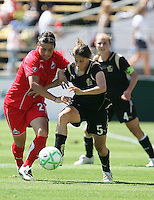 Tina DiMartino (5) and Ali Krieger (27) battle for the ball. FC Gold Pride defeated Washington Freedom 3-2 at Buck Shaw Stadium in Santa Clara, California on August 1, 2009.