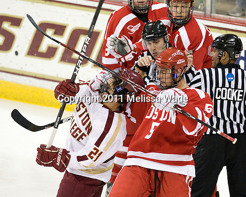 Steven Whitney (BC - 21), Adam Clendening (BU - 5), Bob Bernard, Glen Cooke - The visiting Boston University Terriers shutout the Boston College Eagles and won 5-0 on Sunday, November 13, 2011, at Kelley Rink in Conte Forum in Chestnut Hill, Massachusetts.