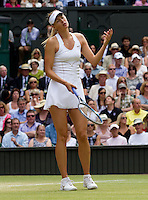 MARIA SHARAPOVA (RUS) (5) against PETRA KVITOVA (CZE) (5) in the Final of the Ladies Singles. Petra Kvitova beat Maria Sharapova 6-3 6-4..Tennis - Grand Slam - Wimbledon - AELTC - London- Day 12 - Sat July 2nd 2011..© AMN Images, Barry House, 20-22 Worple Road, London, SW19 4DH, UK..+44 208 947 0100.www.amnimages.photoshelter.com.www.advantagemedianetwork.com.