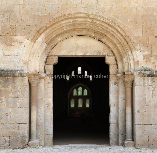 Church portal, Fontenay Abbey, Marmagne, Cote d'Or, France. This Cistercian abbey was founded by Saint Bernard of Clairvaux in 1119, built in the Romanesque style. The abbey itself housed 300 monks from 1200, but was sacked during the French Revolution. The church was built 1139-47 and its entrance is flanked by pillars with carved capitals and an arch. Through the doorway here we can see the flat-ended apse with windows at the far end of the nave. Picture by Manuel Cohen