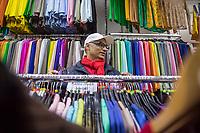 """Das Textilgeschaeft """"Kamil Mode"""" von Hassan Qadri (im Bild in seinem Geschaeft) in Kreuzberg ist von Zwangsraeumung bedroht. Die Kuendigung zum 31. Maerz 2019 durch den Eigentuemer des Hauses am Kottbuser Damm 9, Thorsten Cussler, bedeutet nach 16 Jahren das Aus fuer das Modegschaeft. Cussler will fuer den 61 Quadratmeter grossen Laden zukuenftig ueber 3.000,- Euro Miete, momentan zahlt Hassan Qadri 1.200,- Euro.<br /> Anwohner und Kunden protestieren seit Monaten gegen die Kuendigung, so auch am Freitag den 22. Maerz 2019. Thorsten Cussler beharrt jedoch weiter darauf, dass """"Kamil Mode"""" geschlossen wird.<br /> 22.3.2019, Berlin<br /> Copyright: Christian-Ditsch.de<br /> [Inhaltsveraendernde Manipulation des Fotos nur nach ausdruecklicher Genehmigung des Fotografen. Vereinbarungen ueber Abtretung von Persoenlichkeitsrechten/Model Release der abgebildeten Person/Personen liegen nicht vor. NO MODEL RELEASE! Nur fuer Redaktionelle Zwecke. Don't publish without copyright Christian-Ditsch.de, Veroeffentlichung nur mit Fotografennennung, sowie gegen Honorar, MwSt. und Beleg. Konto: I N G - D i B a, IBAN DE58500105175400192269, BIC INGDDEFFXXX, Kontakt: post@christian-ditsch.de<br /> Bei der Bearbeitung der Dateiinformationen darf die Urheberkennzeichnung in den EXIF- und  IPTC-Daten nicht entfernt werden, diese sind in digitalen Medien nach §95c UrhG rechtlich geschuetzt. Der Urhebervermerk wird gemaess §13 UrhG verlangt.]"""