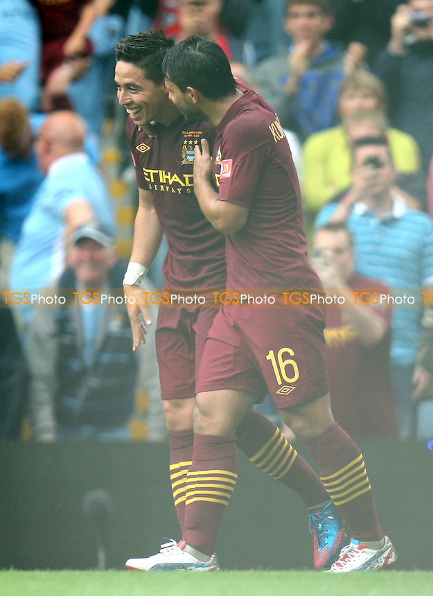 Samir Nasri of Manchester City is congratulated for scoring the third goal -  Chelsea vs Manchester City at the Villa Park Stadium - 12/08/12 - MANDATORY CREDIT: Dave Simpson/TGSPHOTO - Self billing applies where appropriate - 0845 094 6026 - contact@tgsphoto.co.uk - NO UNPAID USE.