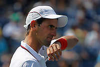 Novak Djokovic of Serbia reacts against  Kei Nishikori of Japan during men semifinal match at the US Open 2014 tennis tournament in the USTA Billie Jean King National Center, New York.  09.05.2014. VIEWpress