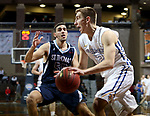 SIOUX FALLS, SD - MARCH 9:  Dylan Janecek #12 From Briar Cliff gets a step past Fotios Malelis #55 from St Thomas during their second round game at the 2018 NAIA DII Men's Basketball Championship at the Sanford Pentagon in Sioux Falls. (Photo by Dave Eggen/Inertia)