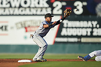 Anyesber Sivira (40) of the Augusta GreenJackets reaches for a throw at second base during the game against the Kannapolis Intimidators at Kannapolis Intimidators Stadium on June 21, 2019 in Kannapolis, North Carolina. The Intimidators defeated the GreenJackets 6-1. (Brian Westerholt/Four Seam Images)