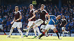 Kenny Miller in the thick of things as he tangles with Danny Wilson