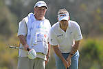 Paul McGinley (IRL) and caddy, Jimmy Rae, line up his putt on the 15th green during Day 3 Saturday of the Open de Andalucia de Golf at Parador Golf Club Malaga 26th March 2011. (Photo Eoin Clarke/Golffile 2011)