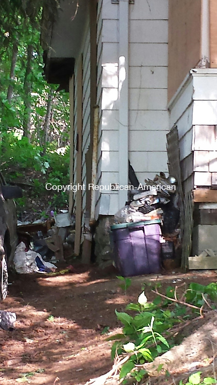 CHESHIRE, CT - June 15, 2014 - 06152014LX05 - A woman who lived in this home on Winslow Street may have died when the floor of her kitchen collapsed.