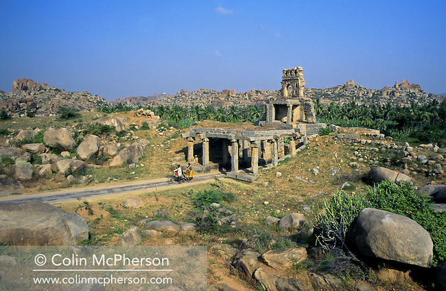 The ruins of the city of Hampi within Vijayanagara in northern Karnataka state, India. Hampi was located within the ruins of Vijayanagara, the former capital of the Vijayanagara empire. Hampi was also called The City of Ruins and was listed as the Group of Monuments at Hampi as a UNESCO World Heritage Site.