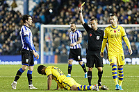 Referee David Webb shows a yellow card to Kieran Lee of Sheffield Wednesday (L) after his foul against Wayne Routledge of Swansea City who s laying to the ground  during the Sky Bet Championship match between Sheffield Wednesday and Swansea City at Hillsborough Stadium, Sheffield, England, UK. Saturday 09 November 2019