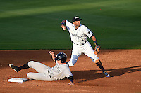 Lakeland Flying Tigers shortstop Dixon Machado (1) attempts to turn a double play catcher Peter O'Brien (24) slides in during a game against the Tampa Yankees on April 5, 2014 at Joker Marchant Stadium in Lakeland, Florida.  Lakeland defeated Tampa 3-0.  (Mike Janes/Four Seam Images)