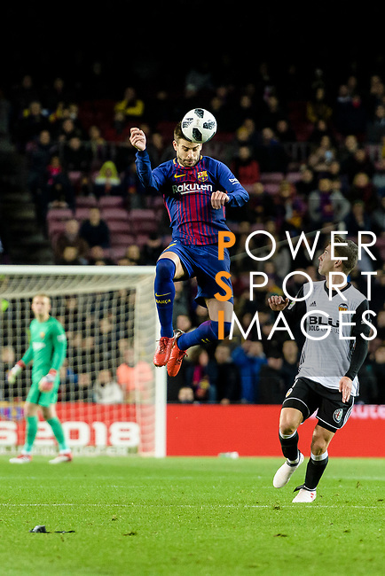 Gerard Pique Bernabeu of FC Barcelona (L) heads the ball during the Copa Del Rey 2017-18 match between FC Barcelona and Valencia CF at Camp Nou Stadium on 01 February 2018 in Barcelona, Spain. Photo by Vicens Gimenez / Power Sport Images