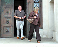 Pictured: The mother of Joshua Davies Hayley (R) and his father Steven (L) coming out of Swansea Crown court after their son's sentence. Friday 02 September 2011<br /> Re: A 16-year-old boy who battered his former girlfriend to death is due to be sentenced on today (Fri 02 September 2011) for her murder.<br /> Rebecca Aylward, 15, from Maesteg, was lured into a wood in Aberkenfig, near Bridgend, in October 2010. <br /> Joshua Davies denied murder, blaming his friend, but was convicted by a 10-2 majority verdict in July.