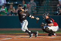 Nick Madrigal (10) of the Kannapolis Intimidators follows through on his swing against the Hickory Crawdads at L.P. Frans Stadium on July 20, 2018 in Hickory, North Carolina. The Crawdads defeated the Intimidators 4-1. (Brian Westerholt/Four Seam Images)