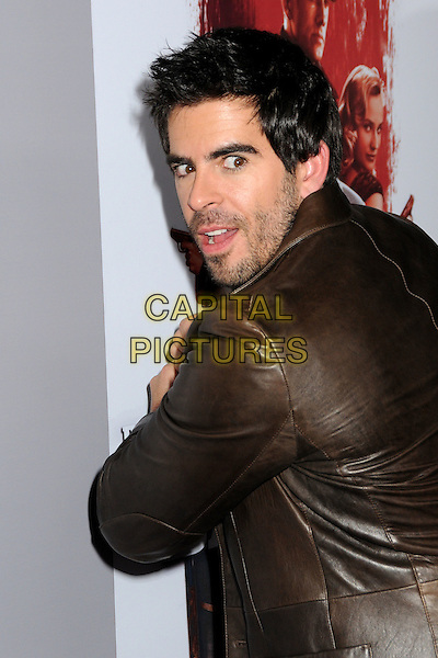 "ELI ROTH .""Inglourious Basterds"" DVD Blu-Ray Release held at the New Beverly Cinema, Los Angeles, California, USA, 14th December 2009..half length hands brown leather  jacket back behind looking over shoulder rear .CAP/ADM/BP.©Byron Purvis/AdMedia/Capital Pictures."