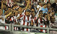 BARRANCABERMEJA- COLOMBIA- 25 -02-2016: Hinchas de Atletico Junior, anima a su equipo, durante partido entre Alianza Petrolera y Atletico Junior, por la fecha 6 de la Liga Aguila I-2016 jugado en el estadio Daniel Villa Zapata de la ciudad de Barrancabermeja. / Fans of Atletico Junior, cheer for their team during a match between Alianza Petrolera and Atletico Junior, for the date 6 of the Liga Aguila I-2016 at the Daniel Villa Zapata Stadium in Barrancabermeja city, Photo: VizzorImage  / Jose D. Martinez / Cont. (Best Quality Available)