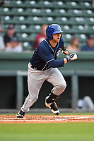 Center fielder Cole Anderson (16) of Asheville Tourists runs toward first in a game against the Greenville Drive on Wednesday, May 3, 2017, at Fluor Field at the West End in Greenville, South Carolina. Greenville won, 8-0. (Tom Priddy/Four Seam Images)