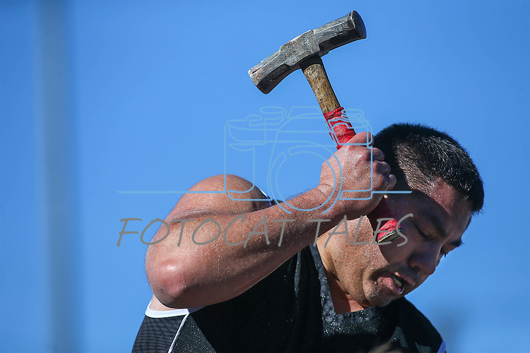 """Tobin Rupert drills 8-19/32"""" in the annual Nevada Day rock drilling competition in Carson City, Nev. on Saturday, Oct. 29, 2016. <br /> Photo by Cathleen Allison"""