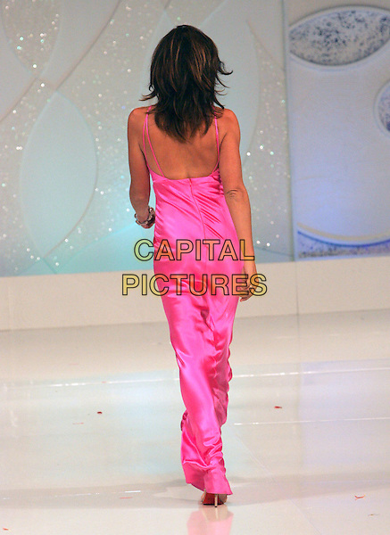 CINDY CRAWFORD.attends Runway for Life, Benefiting St. Jude Children's Research Hospital held at The Beverly Hilton Hotel in Beverly Hills, California, USA, September 15th 2006..full length fashion modelling catwalk show pink dress back behind.Ref: DVS.www.capitalpictures.com.sales@capitalpictures.com.©Debbie VanStory/Capital Pictures
