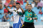 FC Barcelona's Victor Valdes (r) and Real Zaragoza's Gabi Fernandez  during La Liga match.October 23,2010. (ALTERPHOTOS/Acero)