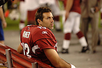 Aug. 31, 2006; Glendale, AZ, USA; Arizona Cardinals quarterback (13) Kurt Warner sits on the sidelines during the game against the Denver Broncos at Cardinals Stadium in Glendale, AZ. Mandatory Credit: Mark J. Rebilas