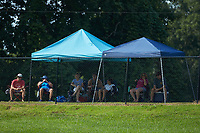 To comply with State of North Carolina mandates during the Covid-19 pandemic only 25 fans are permitted inside the stadium to watch the NC3 baseball game between Kannapolis and Mocksville-Davie at Mando Field at Rich Park on July 4, 2020 in Mocksville, NC.  Those who could not get inside were permitted to watch from outside the fences. (Brian Westerholt/Four Seam Images)