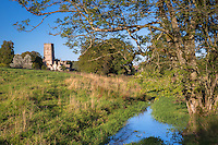 Northleach church, ancient monument in Cotswold landscape and river stream in Gloucestershire, The Cotswolds, UK