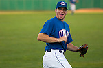 June 29, 2009 -- Omaha Royals left fielder Scott Thorman, from Cambridge, Ontario, goofs around with the bullpen as he heads to the dugout after playing defense against the Albuquerque Isotopes in a minor league professional baseball game on Monday June 29, 2009 in Omaha, Nebraska. PHOTO/Daniel Johnson