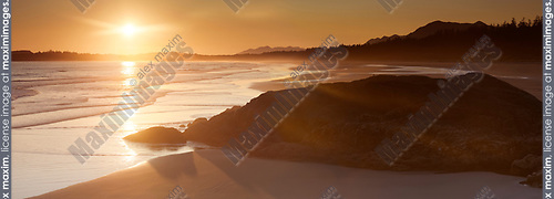 Pacific Rim National Park beach, Beautiful panoramic sunset summertime scenery. Pacific ocean shore in Tofino, Vancouver Island, BC, Canada. Image © MaximImages, License at https://www.maximimages.com