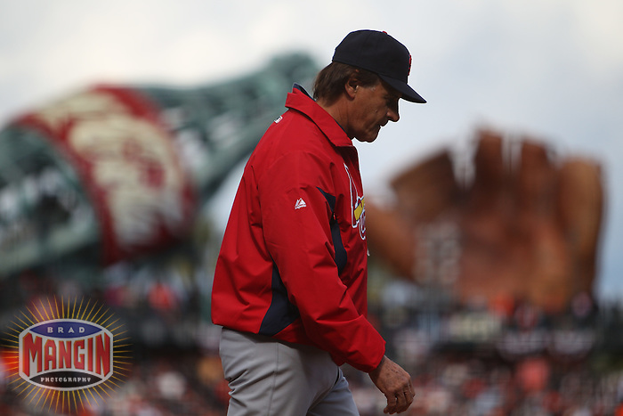 SAN FRANCISCO - APRIL 8:  Manager Tony La Russa of the St. Louis Cardinals walks back to the dugout against the San Francisco Giants during Opening Day at AT&T Park on April 8, 2011 in San Francisco, California. Photo by Brad Mangin
