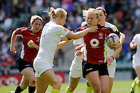 Mandy Marchak of Canada breaks through the tackle of Michaela Staniford of England during the iRB Challenge Cup at Twickenham on Sunday 13th May 2012 (Photo by Rob Munro)