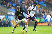 Bolton Wanderers' Sammy Ameobi challenges for the ball against Tim Ream of Fulham<br /> <br /> Photographer Leila Coker/CameraSport<br /> <br /> The EFL Sky Bet Championship - Bolton Wanderers v Fulham - Saturday 10th February 2018 - Macron Stadium - Bolton<br /> <br /> World Copyright &copy; 2018 CameraSport. All rights reserved. 43 Linden Ave. Countesthorpe. Leicester. England. LE8 5PG - Tel: +44 (0) 116 277 4147 - admin@camerasport.com - www.camerasport.com