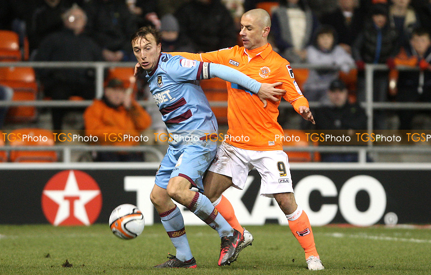 Mark Noble of West Ham and Kevin Phillips of Blackpool - Blackpool vs West Ham United, npower Championship at Bloomfield Road, Blackpool - 21/02/12 - MANDATORY CREDIT: Rob Newell/TGSPHOTO - Self billing applies where appropriate - 0845 094 6026 - contact@tgsphoto.co.uk - NO UNPAID USE..