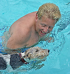 John Crow of Laurel is the enthusiastic swimming coach with his wire-haired fox terrier, Hazel.