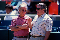 SAN FRANCISCO, CA:  San Francisco Giants managing general partner Peter A. Magowan talks with General Manager Brian Sabean during batting practice before a game at Candlestick Park in San Francisco, California in 1995. (Photo by Brad Mangin)