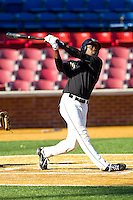 Kevin Jordan #21 of the Wake Forest Demon Deacons follows through on his swing during an intrasquad scrimmage at Wake Forest Baseball Park on January 29, 2012 in Winston-Salem, North Carolina.  (Brian Westerholt / Four Seam Images)