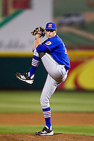 Colin Toalson (27) of the Kansas Jayhawks winds up during a game against the Missouri State Bears at Hammons Field on March 27, 2012 in Springfield, Missouri. (David Welker/Four Seam Images)