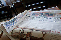 A Globe and Mail and a Toronto Star newspaper are seen on a table in Toronto April 23, 2010.
