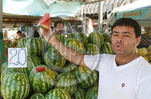 Korca/Korce-Albania - August 03, 2004---A vendor at the central market of Korca, offering watermelon;  project area of GTZ-Wiram-Albania (German Technical Cooperation, Deutsche Gesellschaft fuer Technische Zusammenarbeit (GTZ) GmbH); business-economy-portrait---Photo: Horst Wagner/eup-images