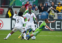 25 April 2010: Seattle Sounders midfielder Peter Vagenas #8 collides with Toronto FC midfielder Julian de Guzman #6 and Toronto FC forward O'Brian White #17 during a game between the Seattle Sounders and Toronto FC at BMO Field in Toronto..Toronto FC won 2-0....