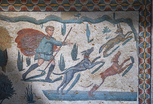 Hunter with dogs. Roman mosaic floor of the Room of The Small Hunt, no 25 - Roman mosaics at the Villa Romana del Casale ,  circa the first quarter of the 4th century AD. Sicily, Italy. A UNESCO World Heritage Site.