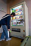 I man buys a bottle of tea from a vending machine made from recycled green tea leaves in Tokyo, Japan. The machine is manufactured by tea-maker ITO EN, LTD., which estimates that it generates approximately 40,000 tons of used tea leaves during the course of beverage manufacturing operations each year. ITO EN has developed a wide array of methods for recycling used tea leaves and incorporating recycled tea leaves into a range of products and materials, including pens, park benches and vending machines.