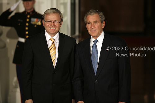 Washington, DC - November 14, 2008 -- United States President George W. Bush greets Kevin Rudd, Prime Minister of Australia to the White House for a working dinner at the start of the G20 Summit on Financial Markets and the World Economy.Credit: Gary Fabiano - Pool via CNP