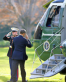 United States President Barack Obama salutes the Marine Guard as he boards Marine 1 to depart the South Lawn of the White House on Friday, November 30, 2012 to travel to Hatfield, Pennsylvania to talk in favor of continuing the middle class tax cut..Credit: Ron Sachs / CNP