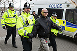 "© Joel Goodman - 07973 332324 . NO SYNDICATION PERMITTED . 21/03/2015 . Newcastle , UK . A Polish man at the demo is arrested for Incitement to Racial Hatred following the burning of an Israeli flag . Neo-Nazis and skinheads from across Europe organise a "" White Man March "" in Newcastle , under the banner of "" National Action "" . Photo credit : Joel Goodman"