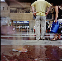 Italians crowd the central bus station or Bologna Centrale Train Station in Bologna, Italy in the summer of 2007.