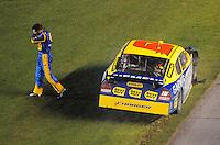 Jul. 5, 2008; Daytona Beach, FL, USA; NASCAR Sprint Cup Series driver Elliott Sadler walks from his car after hitting the wall during the Coke Zero 400 at Daytona International Speedway. Mandatory Credit: Mark J. Rebilas-