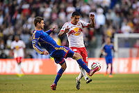 Drew Moor (3) of the Colorado Rapids and Tim Cahill (17) of the New York Red Bulls contest for the ball. The New York Red Bulls and the Colorado Rapids played to a 1-1 tie during a Major League Soccer (MLS) match at Red Bull Arena in Harrison, NJ, on March 15, 2014.