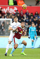 Federico Fernandez of Swansea City challenges Andre Gray of Burnley during the Premier League match between Swansea City and Burnley at The Liberty Stadium, Swansea, Wales, UK. Saturday 06 March 2017
